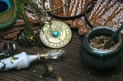 Zodiac talisman with zodiac symbols on a paranormal table. Horoscope wheel. Astrology.