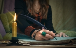 Tarot cards on fortune teller desk table. Future reading. Woman witch writes a magic scroll book with feather pen. Author.