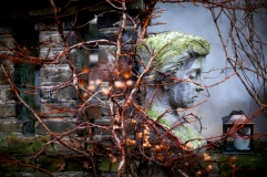 the woman's sculpture in garden. Selective focus