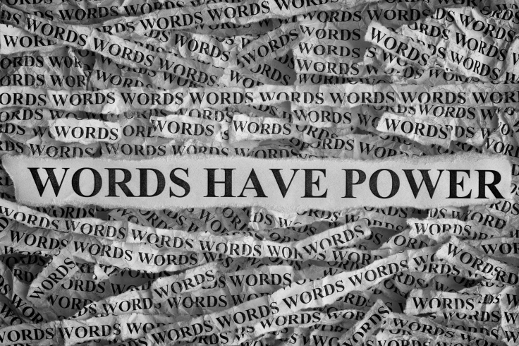 Torn pieces of paper with phrase Words Have Power